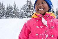 Young girl playing in snow at Kirkwood ski resort near Lake Tahoe, CA.<br />