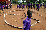 School children pass infront of a map dipicting the map of united Sudan in the courtyard of their school just before South Sudan is to declare independence on July 9th, 2011..Iriya, South Sudan. 01/07/2011..Photo © J.B. Russell