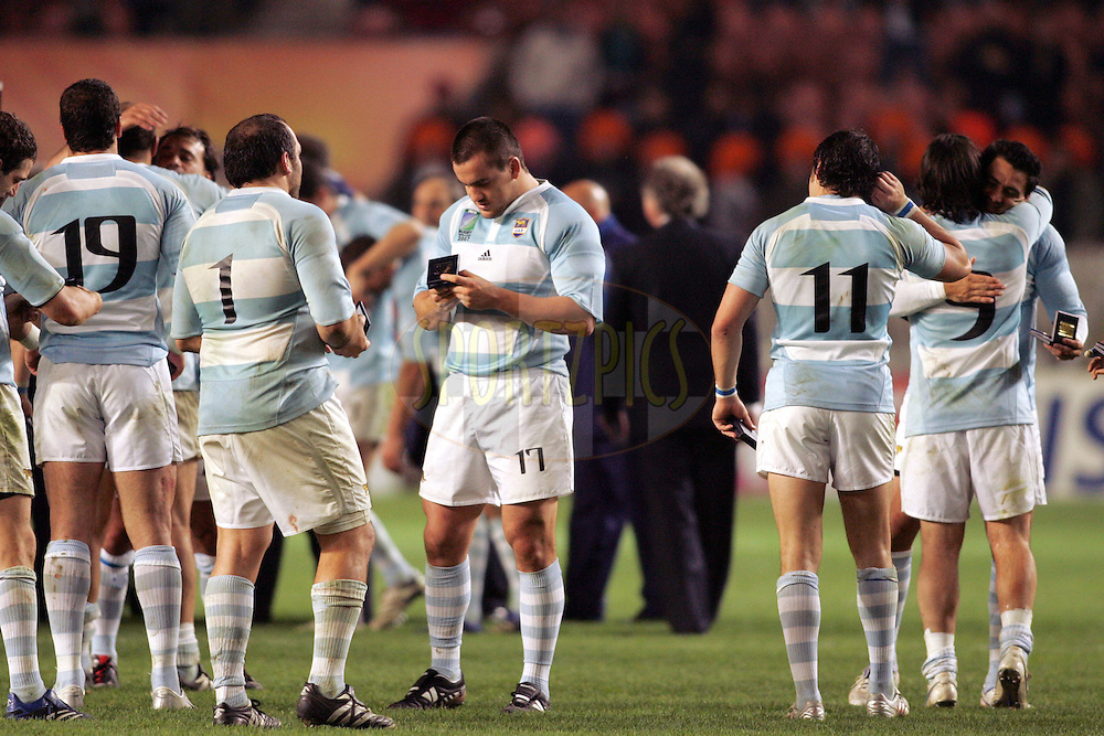 Rugby World Cup, France v Argentina, 19 October 2007. Marcos Ayerza examines his medal at the Parc des Princes, Paris, France. Friday 19 October 2007. Photo: Ron Gaunt/Sportzpics.net