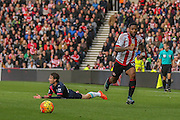 Did Sunderland forward Jermain Lens foul Newcastle United defender Daryl Janmaat  during the Barclays Premier League match between Sunderland and Newcastle United at the Stadium Of Light, Sunderland, England on 25 October 2015. Photo by Simon Davies.