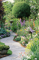 curving path through well planted garden with wooden edging