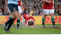 15 June 2013; Jonathan Sexton, British & Irish Lions, goes down with an injury during the first half. British & Irish Lions Tour 2013, NSW Waratahs v British & Irish Lions, Allianz Stadium, Sydney, NSW, Australia. Picture credit: Stephen McCarthy / SPORTSFILE