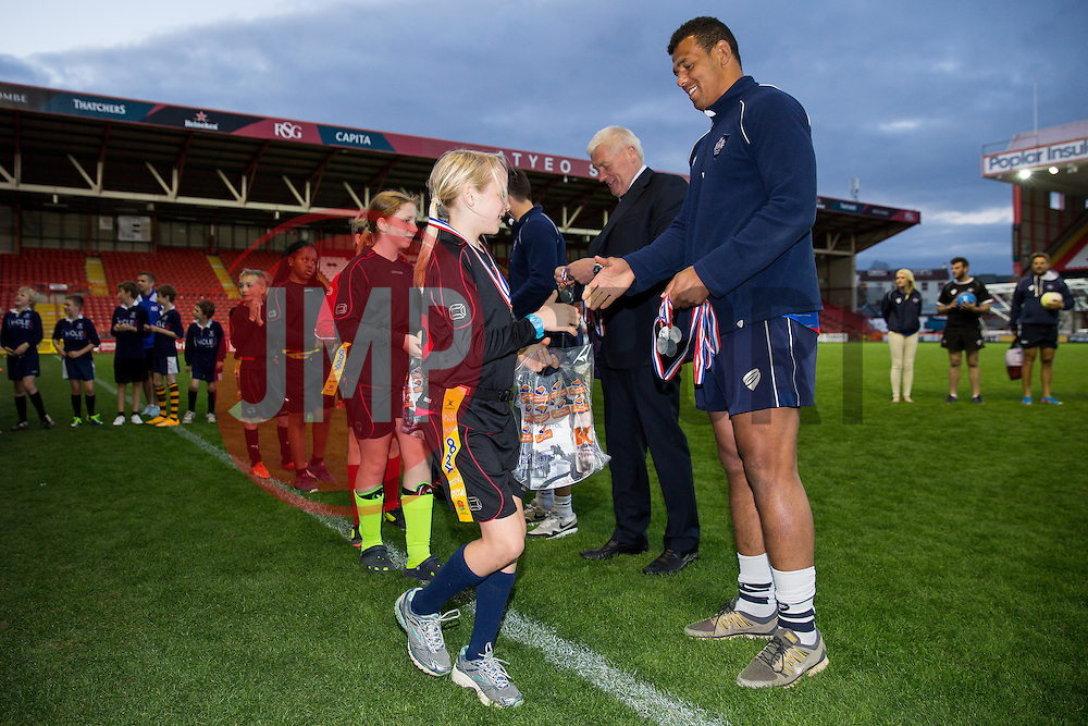 Benn Glynn of Bristol Rugby presents the second placed Henleaze School with medals - Photo mandatory by-line: Rogan Thomson/JMP - Mobile: 07966 386802 - 22/04/2015 - SPORT - Rugby Union - Bristol, England - Ashton Gate - Bristol Sport Schools Cup Rugby.