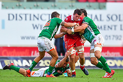 Ed Kennedy of Scarlets is tackled by Enjel Makelara of Benetton Treviso<br /> <br /> Photographer Craig Thomas/Replay Images<br /> <br /> Guinness PRO14 Round 3 - Scarlets v Benetton Treviso - Saturday 15th September 2018 - Parc Y Scarlets - Llanelli<br /> <br /> World Copyright © Replay Images . All rights reserved. info@replayimages.co.uk - http://replayimages.co.uk
