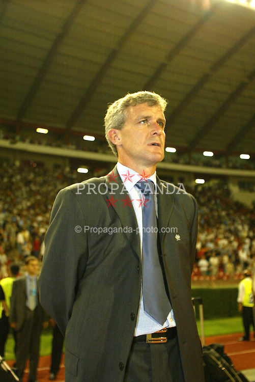 BELGRADE, SERBIA & MONTENEGRO - Wednesday, August 20, 2003: Wales' manager Mark Hughes stands for the national anthem before the UEFA European Championship qualifying match against Serbia & Montenegro at the Red Star Stadium. (Pic by David Rawcliffe/Propaganda)