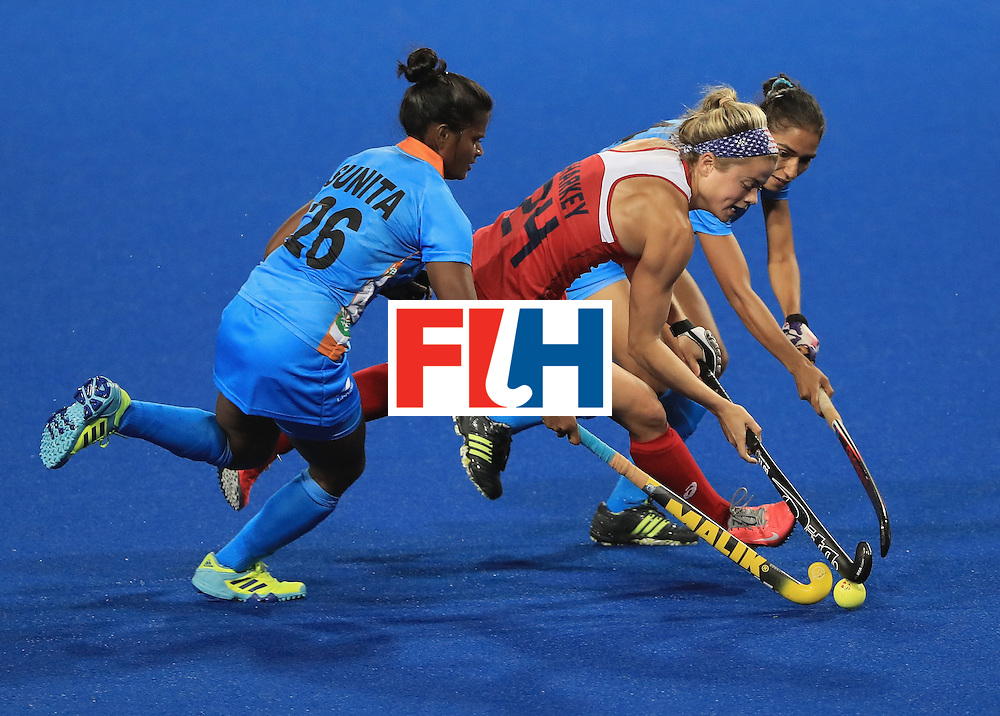 RIO DE JANEIRO, BRAZIL - AUGUST 11:  Kathleen Sharkey #24 of the United States attempts to run past Sunita Lakra #26 of India during a Women's Preliminary Pool B match at the Olympic Hockey Centre on August 11, 2016 in Rio de Janeiro, Brazil.  (Photo by Sam Greenwood/Getty Images)
