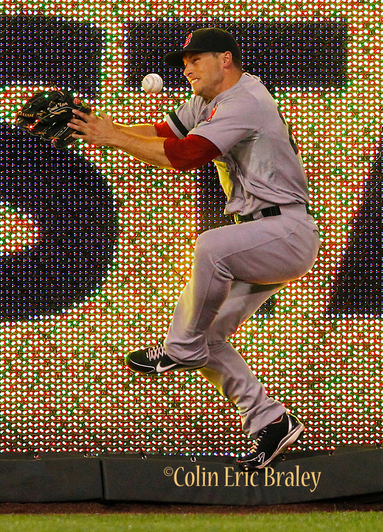 Boston Red Sox right fielder Daniel Nava is unable to hold on to a fly ball from Kansas City Royals' Brett Hayes in the eighth inning of a baseball game at Kauffman Stadium in Kansas City, Mo., Saturday, Aug. 10, 2013. (AP Photo/Colin E. Braley)