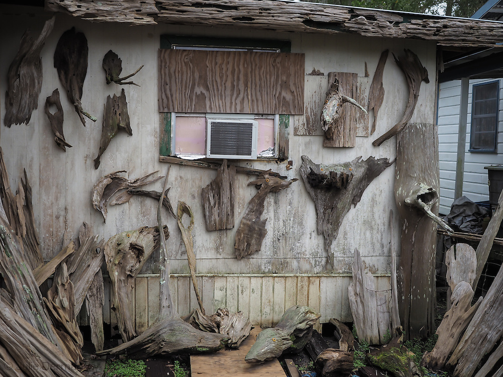Scultures by self-taught artist, Adam Morales on the wall of Adam's Cypress Swamp Driftwood Family Museum in Pierre Part, Louisiana.