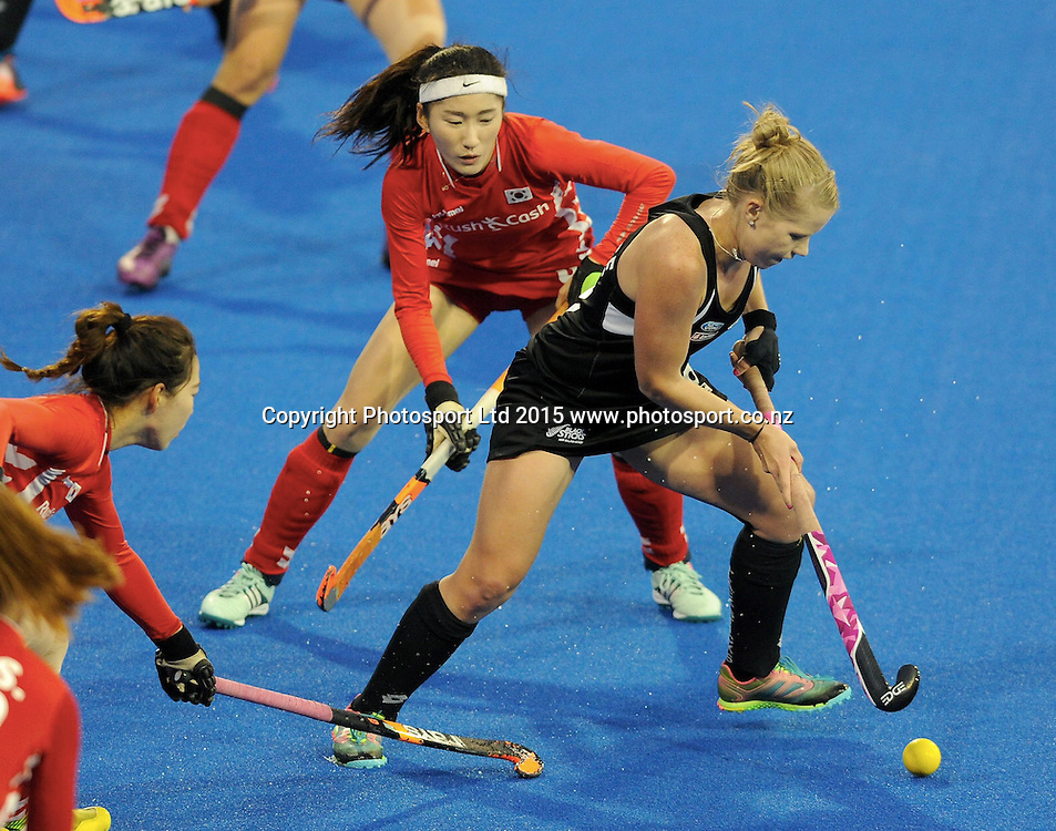 New Zealand Black Stick Kirsten Pearce looks for a way past Korea in the Festival of Hockey, New Zealand Womens Black Sticks v Korea, Unison Sports Park, Hastings, Saturday, April 118 2015. Photo: Kerry Marshall / photosport.co.nz