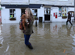 Boxing Day floods.. Residents in Yalding, Kent survey the scene as they  brace themselves for the possibility of  more flooding with another storm on the way, Thursday, 26th December 2013. Picture by Stephen Lock / i-Images
