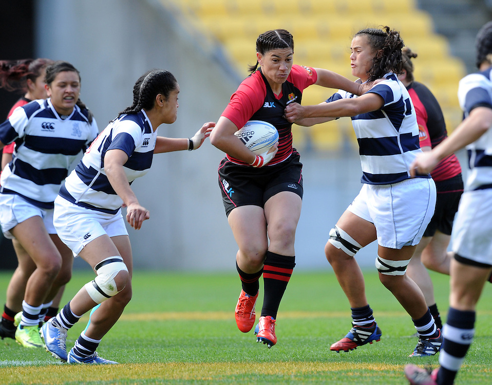 Canterburys' Amiria Rule busts through the Auckland defence in the Women's National Provincial Rugby Final at Westpac Stadium, Wellington, New Zealand, Saturday, October 26, 2013. Credit:SNPA / Ross Setford