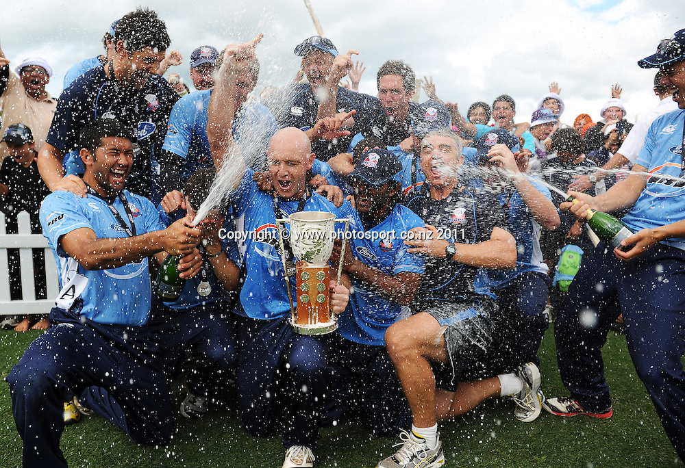 Aces team photo as they celebrate winning the HRV Twenty20 Cricket Final between the Auckland Aces and Canterbury Wizards at Colin Maiden Oval in Auckland, New Zealand on Sunday 22 January 2012. Photo: Andrew Cornaga/Photosport.co.nz