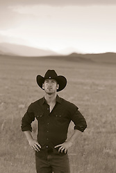 Cowboy standing on a ranch in New Mexico