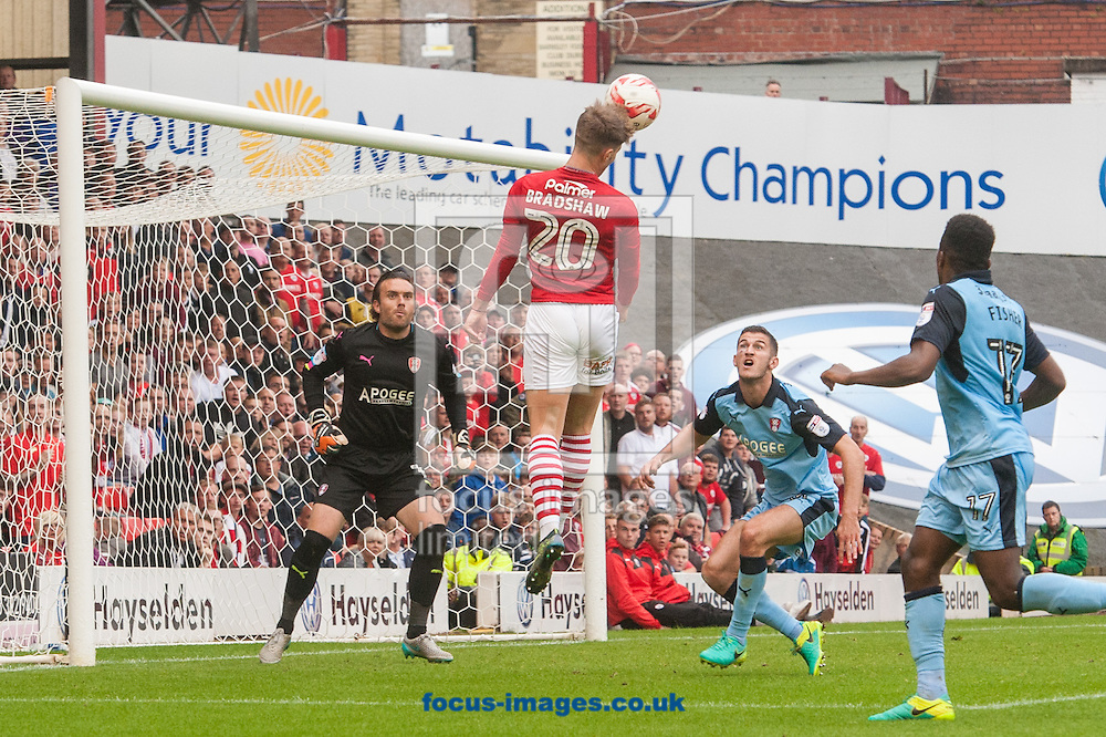 Tom Bradshaw of Barnsley leaps to head home his sides third goal during the Sky Bet Championship match at Oakwell, Barnsley<br /> Picture by Matt Wilkinson/Focus Images Ltd 07814 960751<br /> 27/08/2016