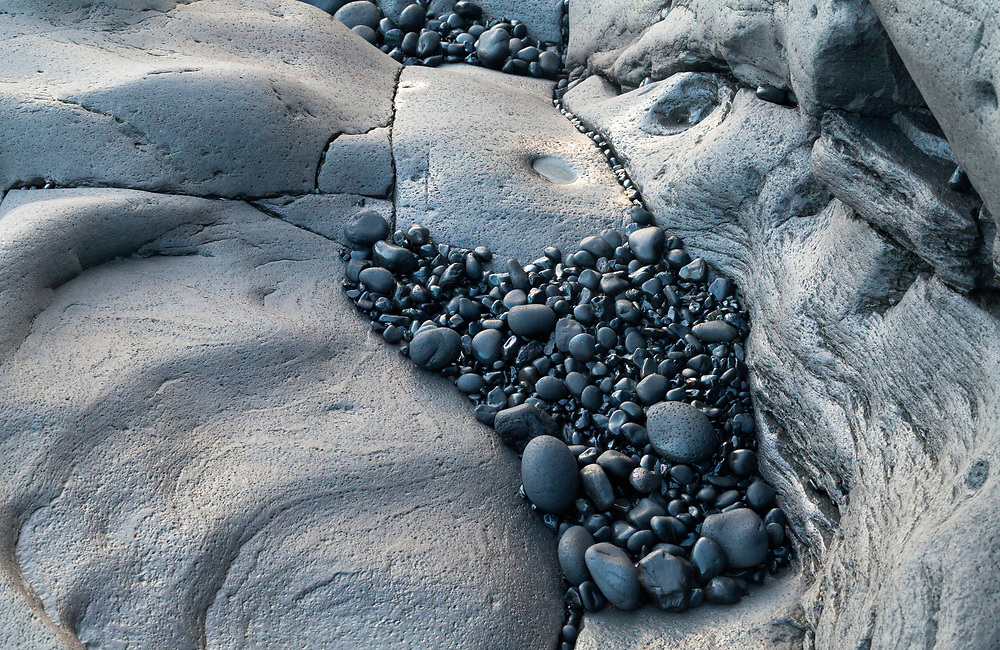 Black stones in a rock on Dritvik beach, Iceland