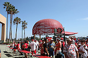 ANAHEIM, CA - JULY 26:  Palm trees and a large metal baseball cap stand large in the background as fans cue up for the Los Angeles Angels of Anaheim game against the Detroit Tigers at Angel Stadium on Saturday, July 26, 2014 in Anaheim, California. The Angels won the game in a 4-0 shutout. (Photo by Paul Spinelli/MLB Photos via Getty Images)