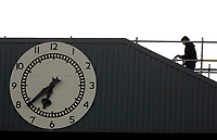 Photo: Daniel Hambury.<br />Arsenal v Wigan Athletic. The Barclays Premiership. 07/05/2006.<br />Arsenal's famous clock shows 6.39 as a workman makes his way.