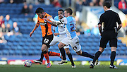 Emmanuel Ledesma, Brighton midfielder and Jay Spearing, Blackburn Rovers midfielder during the Sky Bet Championship match between Blackburn Rovers and Brighton and Hove Albion at Ewood Park, Blackburn, England on 21 March 2015.