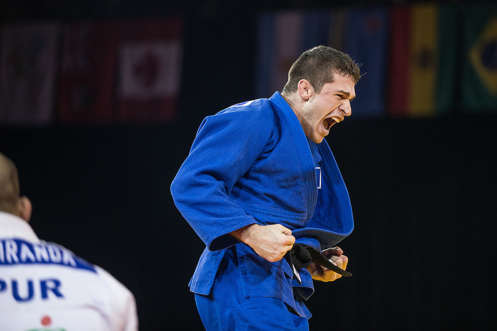 Victor Penalber of Brazil celebrates his win over Gadiel Miranda of Puerto Rico in their bronze medal contest in the men's judo -81kg class at the 2015 Pan American Games in Toronto, Canada, July 13,  2015.  AFP PHOTO/GEOFF ROBINS