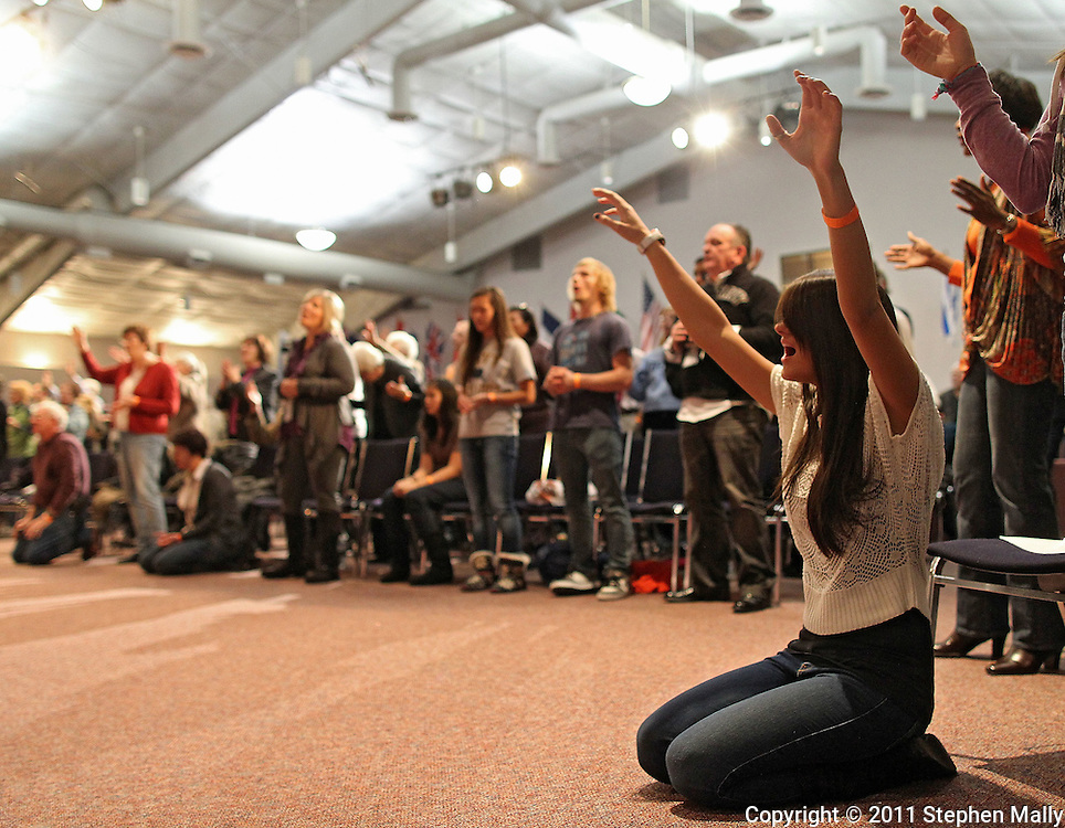 Tara Lumbard of Cedar Rapids kneels as she prays during The Response Iowa at River of Life Ministries, 3801 Blairs Ferry Rd NE, in Cedar Rapids on Tuesday evening, December 6, 2011. The Response gathered people from all ages, denominations and backgrounds in prayer and fasting on behalf of the nation. (Stephen Mally/Freelance)