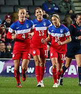 Alex Morgan of USA Women (centre) celebrates scoring the opening goal against England Women during the International Friendly match at stadium:mk, Milton Keynes<br /> Picture by David Horn/Focus Images Ltd +44 7545 970036<br /> 13/02/2015