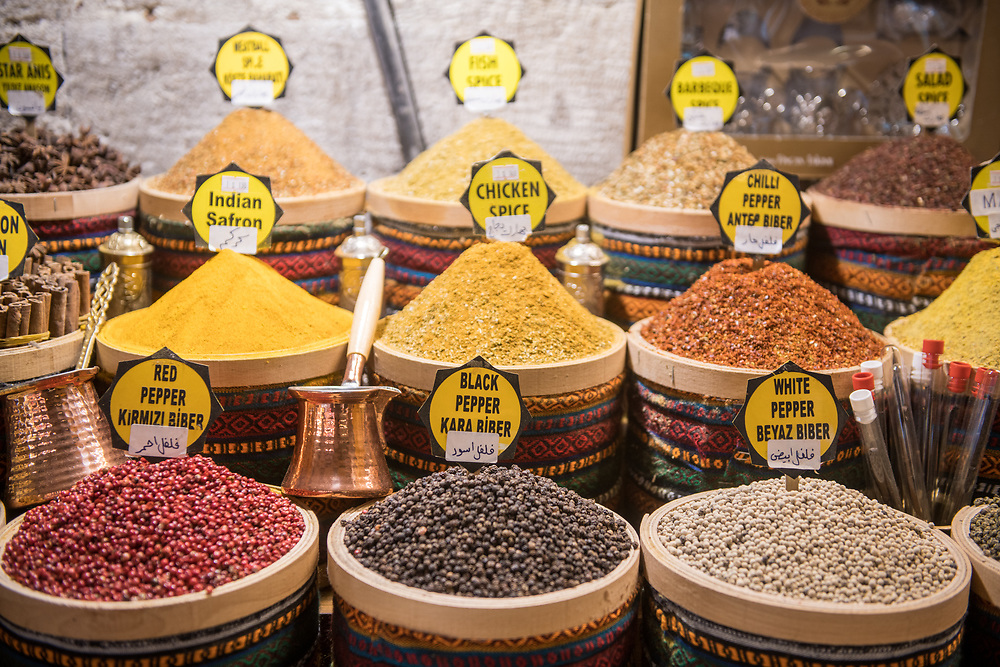 Stocked baskets of savory spices on display for sale at Istanbul Spice bazaar in Turkey