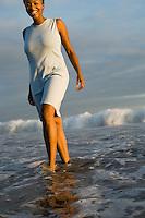 Woman walking through surf