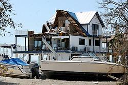 Hurricane Irma's powerful winds pushed boats onto a seawall and sheared off the side of a home on Cutjoe Key, FL, USA, home exposing the inside on Tuesday, September 12, 2017. Photo by Taimy Alvarez/Sun Sentinel/TNS/ABACAPRESS.COM