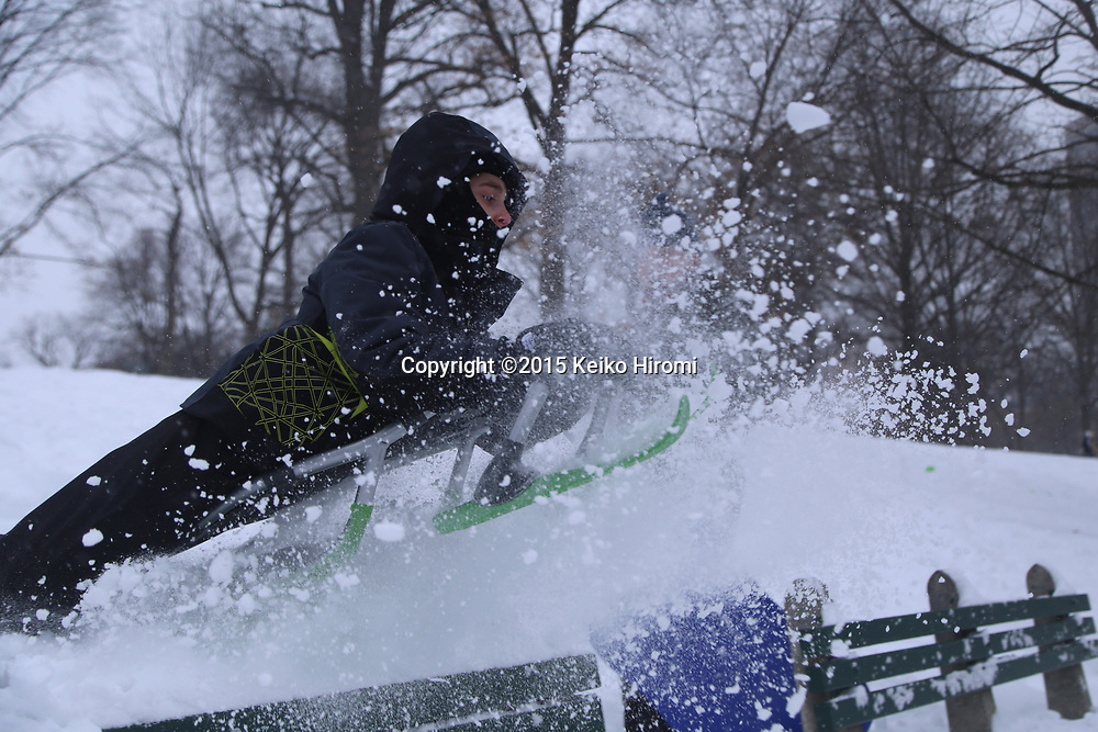 January 27 2015, Boston, MA USA: People enjoy skiing and snowboarding at Boston Common in Boston, MA.  Massachusetts was pounded by snow and lashed by strong winds early Tuesday as bands of heavy snow left some towns including Sandwich on Cape Cod and Oxford in central Massachusetts reporting more than 18 inches of snow.(