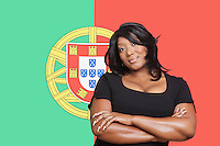 Portrait of casual mixed race woman against Portuguese flag