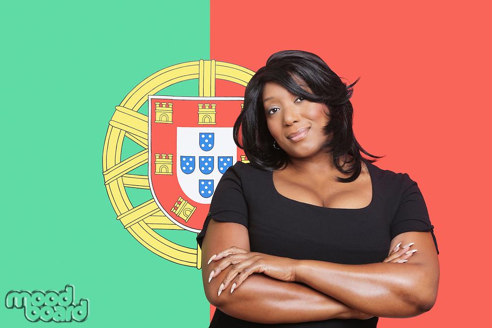 Portrait of casual mixed race woman against Portuguese flag