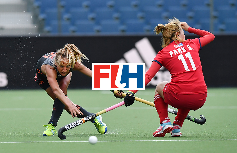 BRUSSELS, BELGIUM - JUNE 24: Seunga Park (R) of Korea and Lauren Stam (L) of Netherlands during the FINTRO Women's Hockey World League Semi-Final Pool A game between Korea and Netherlands on June 24, 2017 in Brussels, Belgium. (Photo by Charles McQuillan/Getty Images for FIH)