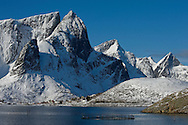 The mountains surrounding Reinefjord in winter, from Olenilsoy, Moskenesoya, Lofoten Islands, Arctic Norway