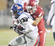 Ole Miss Rebels wide receiver Cody Core (88) is tackled by Arkansas Razorbacks cornerback D.J. Dean (2) at Donald W. Reynolds Razorback Stadium in Fayetteville, Ark. on Saturday, November 22, 2014. Arkansas won 30-0.