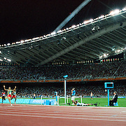 Hicham El Guerrouj of Morocco celebrates after winning the Gold Medal in the men's 5,000 meter final during the Athens 2004 Summer Olympic Games at the Olympic Stadium, Athens, Greece. 28th August 2004. Photo Tim Clayton