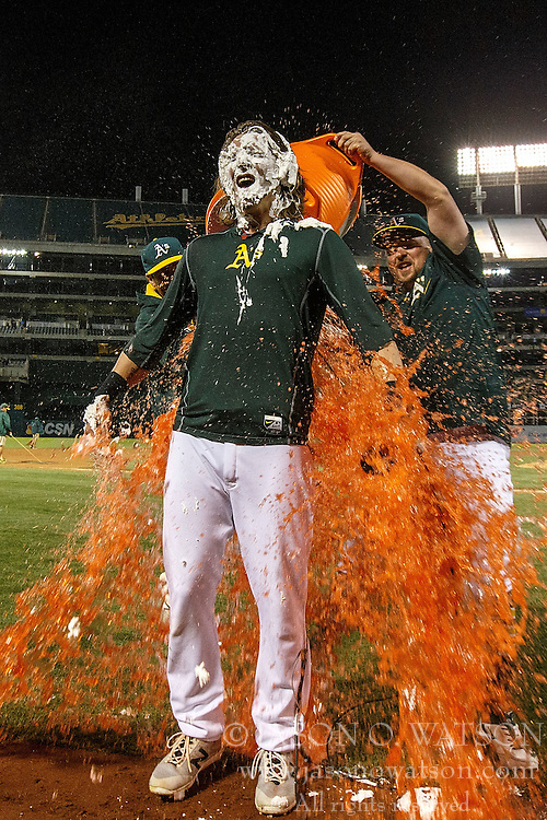 OAKLAND, CA - JULY 19:  Billy Butler #16 of the Oakland Athletics pours Gatorade on Josh Reddick #22 after Reddick hit a walk off single against the Houston Astros during the tenth inning at the Oakland Coliseum on July 19, 2016 in Oakland, California. The Oakland Athletics defeated the Houston Astros 4-3 in 10 innings. (Photo by Jason O. Watson/Getty Images) *** Local Caption *** Billy Butler; Josh Reddick