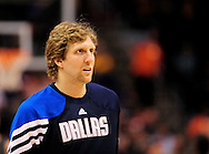 Mar. 08, 2012; Phoenix, AZ, USA;  Dallas Mavericks forward Dirk Nowitzki (41) reacts while on the court during a game against the Phoenix Suns at the US Airways Center.  The Suns defeated the Mavericks 96-94. Mandatory Credit: Jennifer Stewart-US PRESSWIRE.