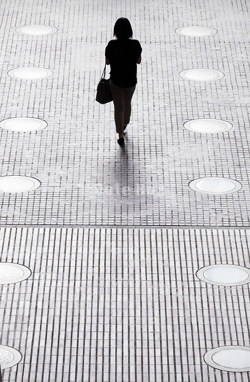 silhouette of woman with handbag walking