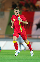 LLANELLI, WALES - Wednesday, August 15, 2012: Wales' Sam Vokes in action against Bosnia-Herzegovina during the international friendly match at Parc y Scarlets. (Pic by David Rawcliffe/Propaganda)
