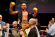 Ben Jones celebrates beating  Martin Parlagi for the WBO Intercontinental featherweight title during the 'Judgement Day' show at The Troxy, Limehouse, London. October 30, 2015.<br /> James Boardman / Telephoto Images<br /> +44 7967 642437
