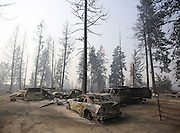 The shells of cars are all that remain after a wildfire swept through the community on White Rock Road, destroying several houses, in Okanogan Sunday, August 23, 2015.<br />