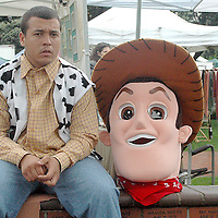 Christopher Andrews sits next to his Woody costume (Toy Story) at the Santa Monica Farmers Market on Sunday, October 17 , 2010. Woody was promoting Robinsen Beautilities Halloween Headquarters.
