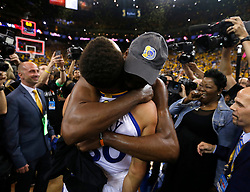 The Golden State Warriors' Kevin Durant embraces teammate Stephen Curry (30) after defeating the Cleveland Cavaliers, 129-120, in Game 5 of the NBA Finals at Oracle Arena in Oakland, Calif., on Monday, June 12, 2017. (Photo by Nhat V. Meyer/Bay Area News Group/TNS) *** Please Use Credit from Credit Field ***