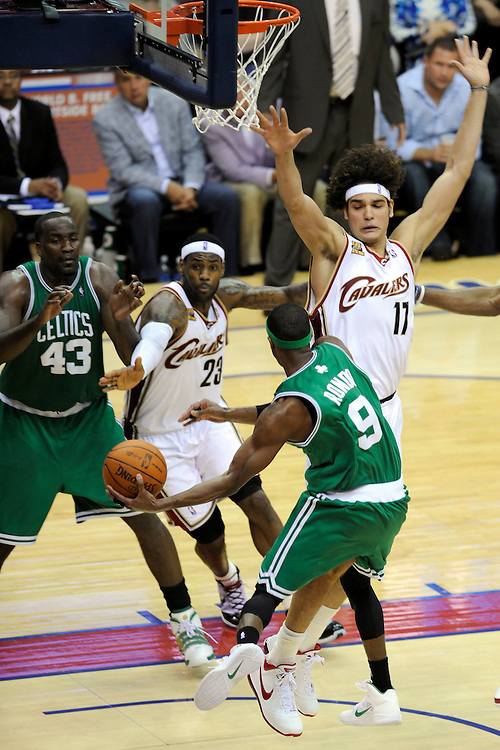 May 1, 2010; Cleveland, OH, USA; Boston Celtics guard Rajon Rondo (9) tries to pas to center Kendrick Perkins (43) with pressure from Cleveland Cavaliers forward LeBron James (23) and forward Anderson Varejao (17) during the third quarter of game one in the eastern conference semifinals in the 2010 NBA playoffs at Quicken Loans Arena. The Cavaliers beat the Celtics 101-93. Mandatory Credit: Dave Miller-US PRESSWIRE