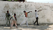 A group of boys throw rocks at Haitian police during riots in Port-au-Prince, Haiti, May 1995. (Phoot by Roger M. Richards)
