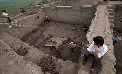 Workers excavate the burial grounds dated 5,000 to 7,000 years ago in Xichuan county of Henan Province in China on 28 June 2010. Chinese authorites hasten to save the relics from 151 archaelogical sites that would be submerged after the completion of the Danjiangkou Dam reservoir, part of the central route of the South-to-North Water Diversion (SNWD) project. The SNWD project, the largest known water diversion project, was started in 1952 to solve the country's chronic water shortages and involves creating three routes to channel 44.8 billion cu m of water from southern China to the northern areas. As part of the project's central route, affecting Henan and Hubei provinces, water from the Danjiangkou Dam reservoir will be diverted to Beijing.