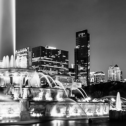 Chicago skyline at night panoramic picture in black and white. Panorama photo ratio is 1:3 and includes Buckingham Fountain, Willis Tower (Sears Tower), CNA building, Trump Tower, Prudential plaza, and other Chicago buildings.