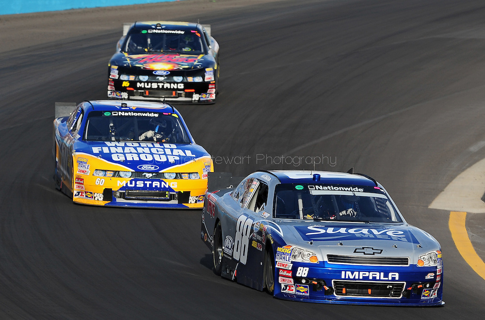 Nov. 12 2011; Avondale, AZ, USA; NASCAR Nationwide Series driver Aric Almirola (88) leads Carl Edwards (60) and Trevor Bayne (16) during the Wypall 200 at Phoenix International Raceway. Mandatory Credit: Jennifer Stewart-US PRESSWIRE