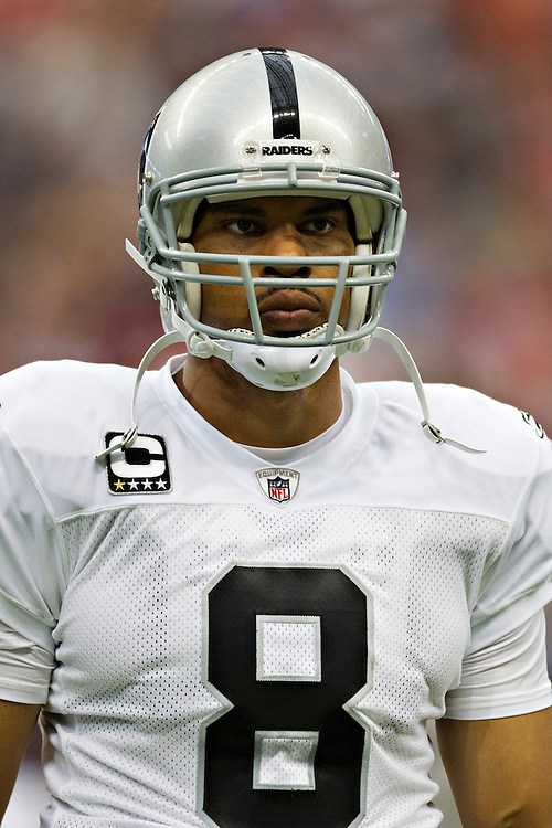 HOUSTON, TX - OCTOBER 9:   Jason Campbell #8 of the Oakland Raiders warms up before a game against the Houston Texans at Reliant Stadium on October 9, 2011 in Houston, Texas.  The Raiders defeated the Texans 25 to 20.  (Photo by Wesley Hitt/Getty Images) *** Local Caption *** Jason Campbell