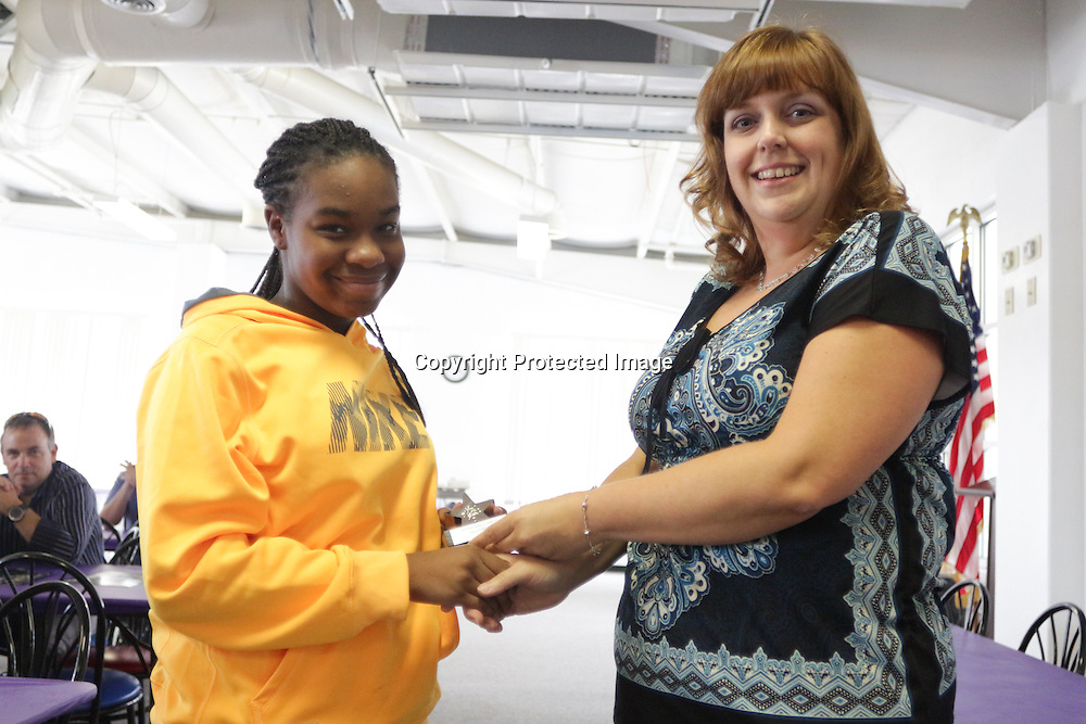 Isley Pulliam accepts an award from Star News Editor Sherry Jones for the 15 Under 15 project Sunday September 14, 2014 at Jungle Rapids in Wilmington, N.C. (Jason A. Frizzelle)